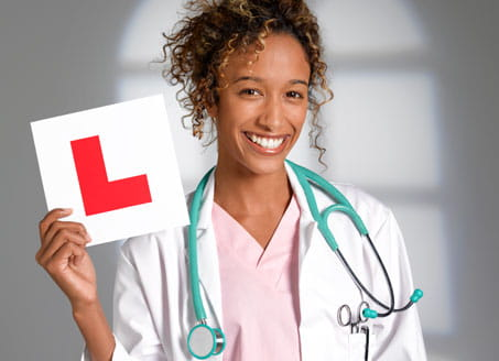 Image of doctor holding L plate. Credit: Getty Images
