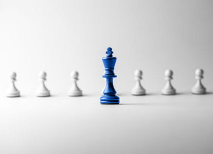 Chess piece standing out to signify leadership