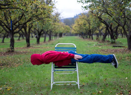 Teenager lying down on chair