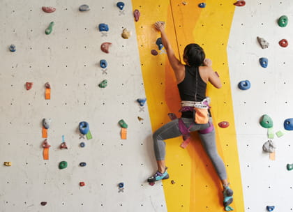 woman indoor mountain climbing